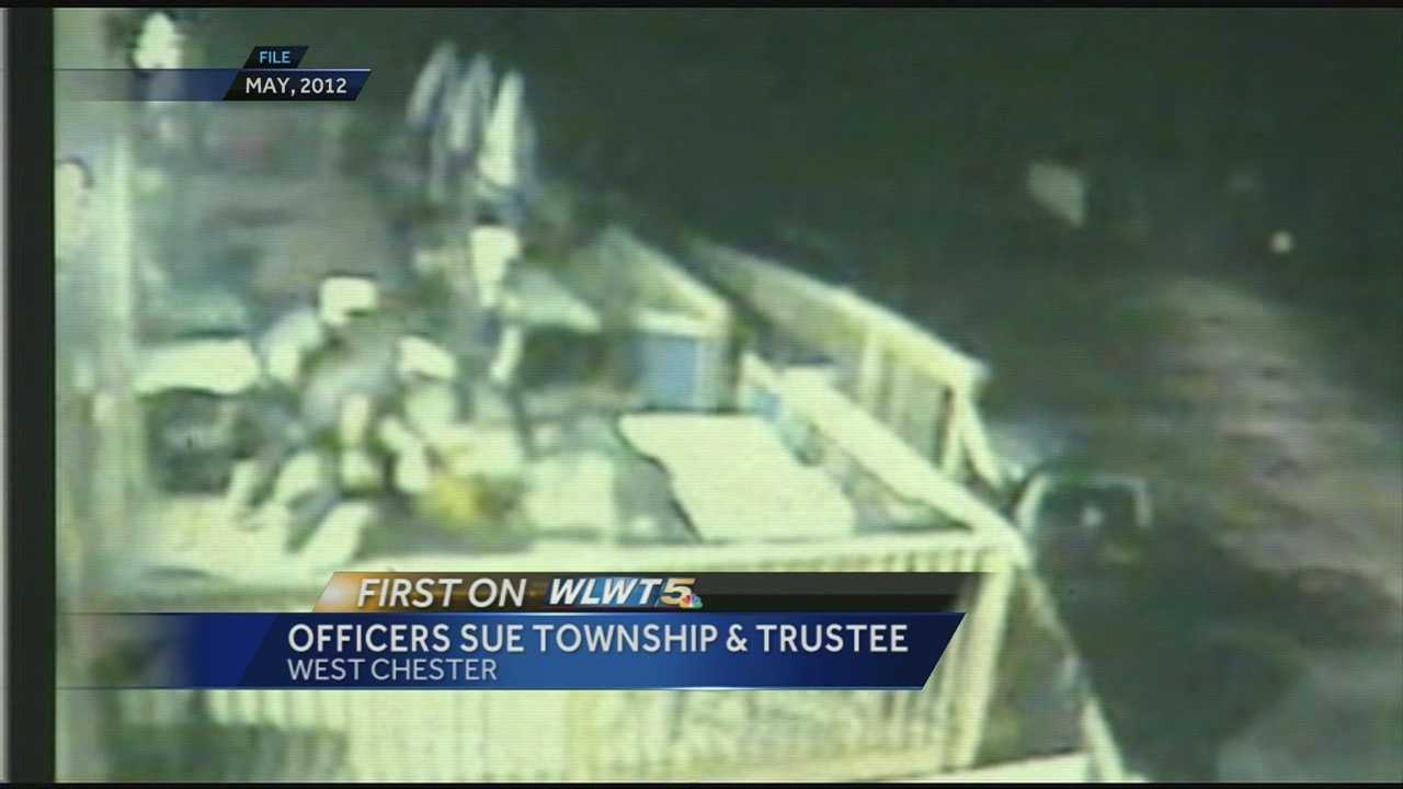 Officers sue township, trustee