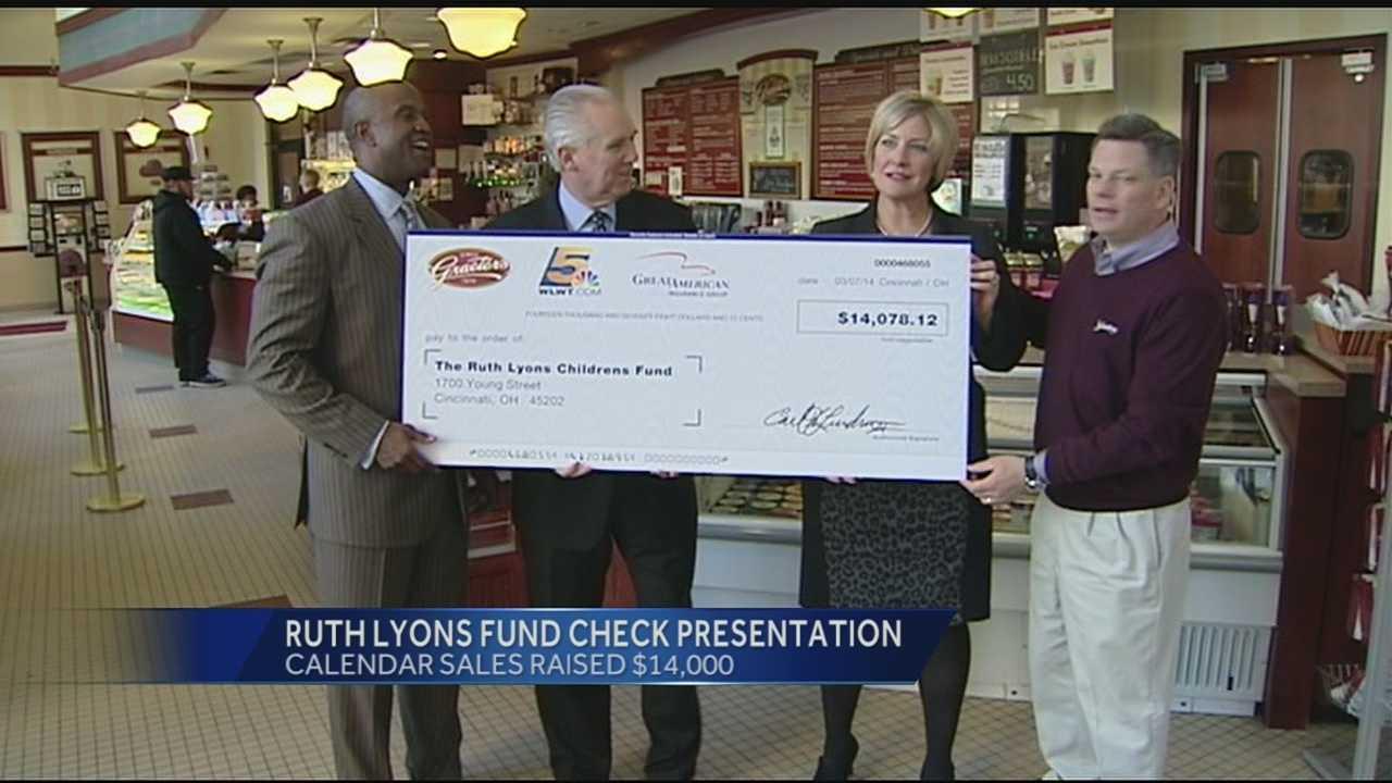 Ruth Lyons accepts check from Cincinnati Landmarks Calendar sales