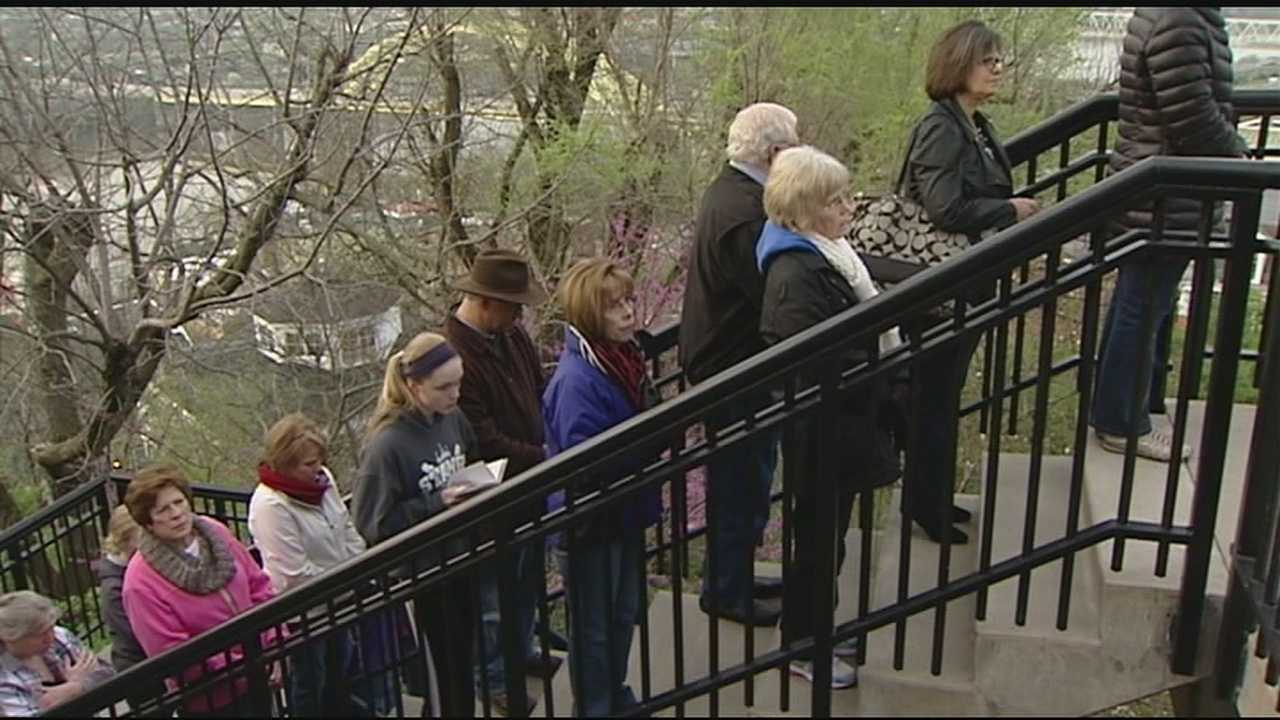 People pray the steps at Holy Cross-Immaculata Church Friday