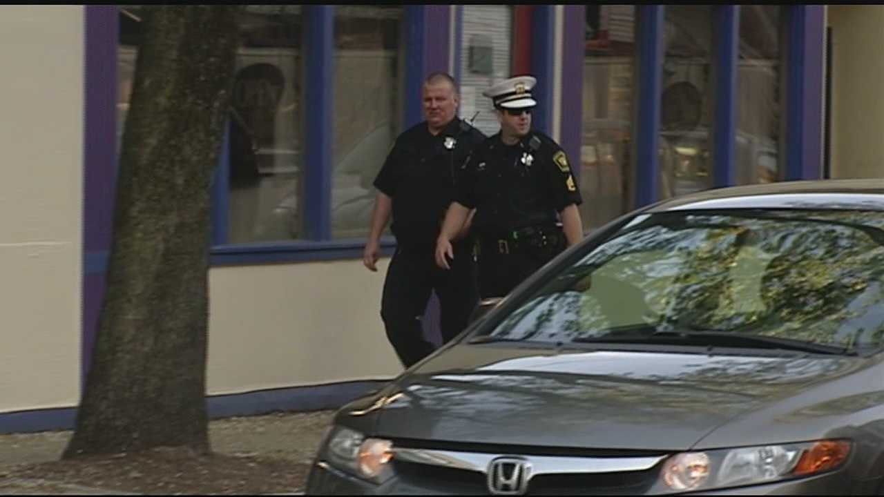 Two businesses were boarded up and are now property of the Cincinnati Police Department after a raid Thursday.