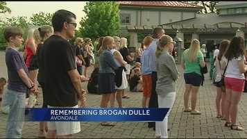 Friends and family members of Brogan Dulle gather at the Cincinnati Zoo to hold a vigil for Brogan Dulle Tuesday night. The vigil was originally planned to be a rally for volunteers but organizers changed the tone after Dulle's body was found.
