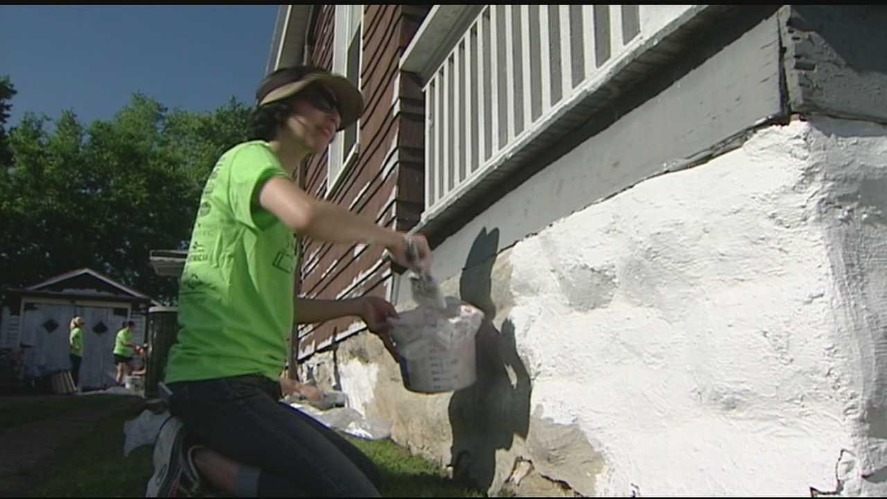 Volunteers paint 37 homes in Covington
