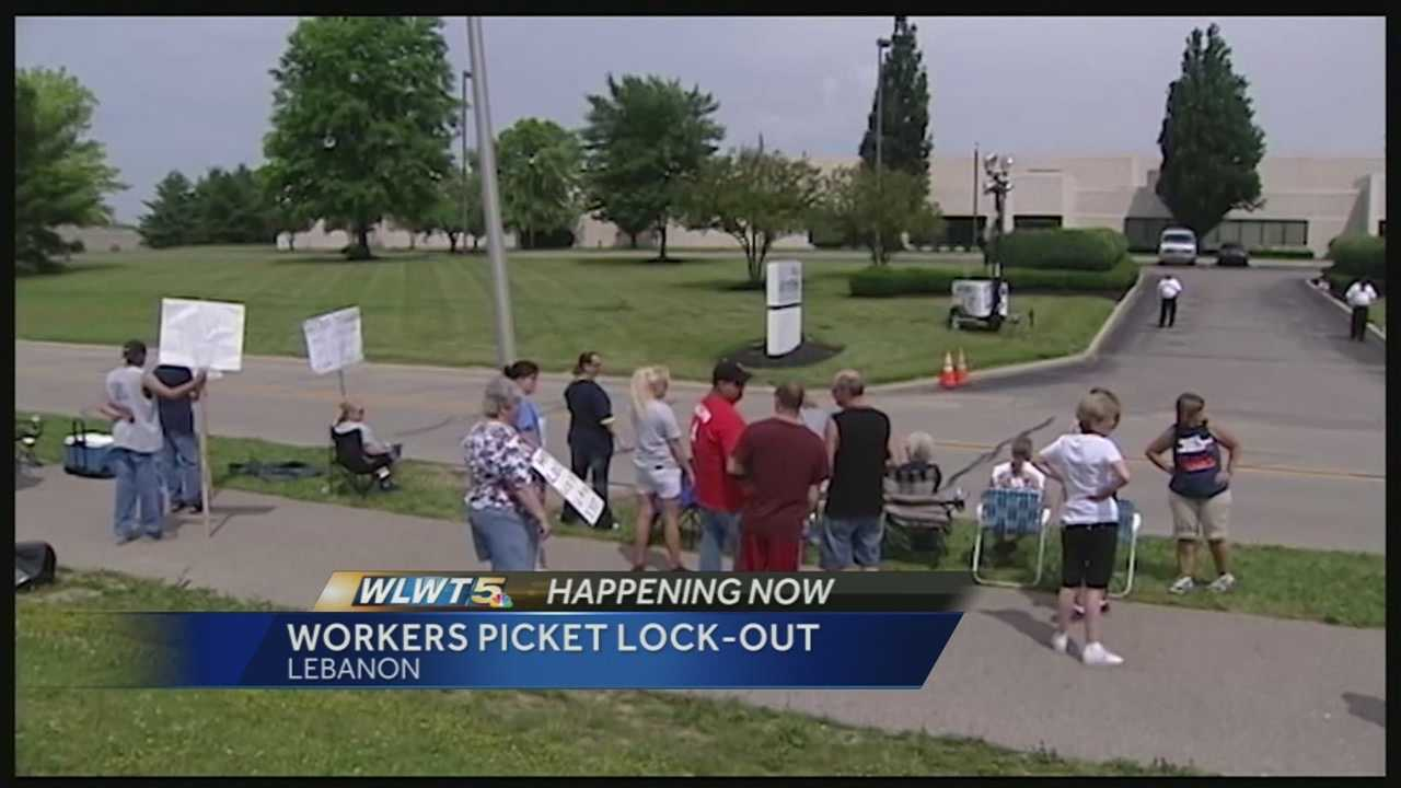 UAW workers picket after being locked out of work