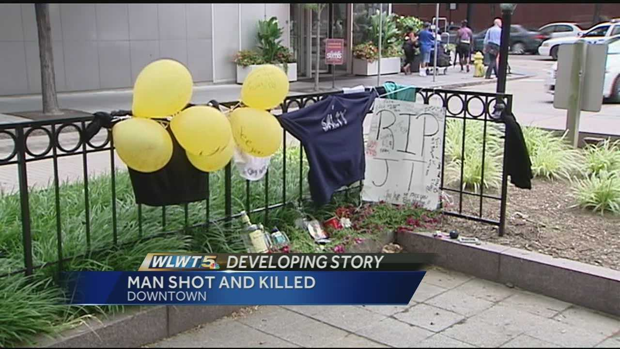 Family, friends gather in Piatt Park to remember shooting victim