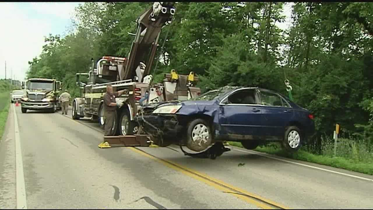 Family's car hydroplanes, flips into creek off SR 741