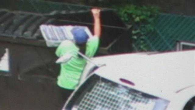 Raw: Postal worker dumps what appears to be mail in dumpster
