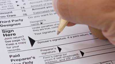 Signing tax form, taxes, signature, money