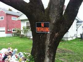 A no trespassing sign has been placed on a tree outside the Violette Avenue home in Waterville.