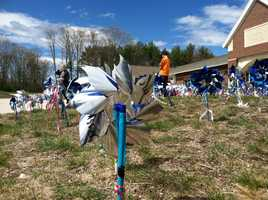 In Kennebunk Friday morning, students at the elementary school planted blue pinwheels.