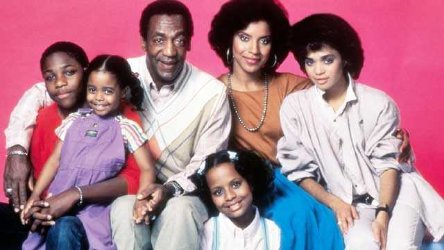 The Cosby Show cast on pink background