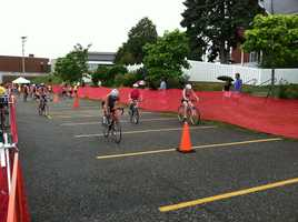 Athletes begin the cycling portion of the race.