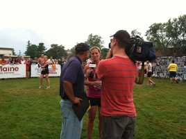 News 8's Norm Karkos and photojournalist Sean Guiggey interview an athlete.