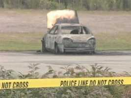 Bangor Police find thee bodies in a burning car. Police say the tree were killed by Randal Daluz and Nicholas Sexton. The two remained at large for several weeks following the murders.