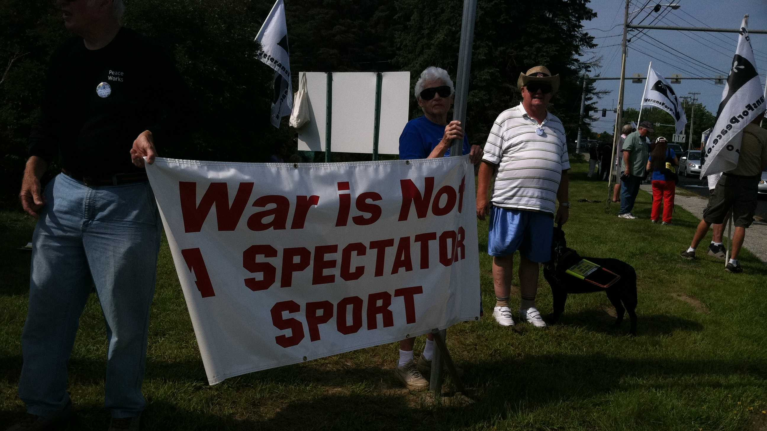 Protesters at the air show on Saturday