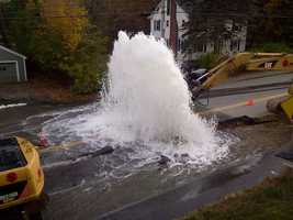 A huge water main break sent a geyser of water shooting from Court Street in Auburn on Monday.