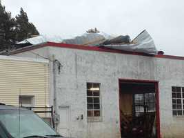 High winds peeled the roof off this business in Old Town.