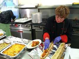 CVC Catering co-founder and chef Nancy Cerny, creates her fennel sausage baguettes.