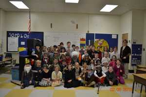 Second and third grade students in Mrs Martin's and Mrs. Espejo's classes at Fairview Elementary School in Auburn got to dress up an get a lesson on life in Maine 100 years ago on the 100th day of school.