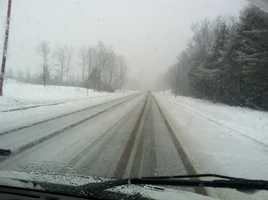 Snow is accumulating on Route 26 West Paris