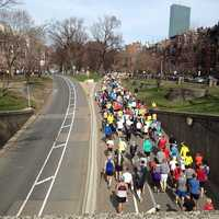 This is the view from the Mass Avenue overpass as runners were released from the makeshift finish area to get their belongings after the marathon was stopped.