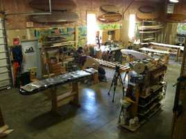 With old-fashioned tools, Mike Laveccia and his half-dozen employees are building some of the most modern surfboards in the world.