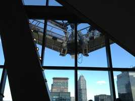 A photo from the 44th floor of the Hearst Tower showing the scaffold outside the windows.