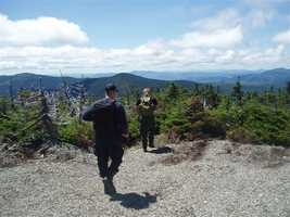 Game Warden Sgt. Jeff Spencer and Maine State Police Detective Lenny Bolton hiked toward Spaulding Mountain from the summit of Sugarloaf Mountain.