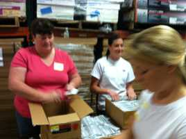 Volunteers at Ruth's Reusable Resources in Portland are filling backpacks with donated school supplies as part of the Tools for Schools campaign.