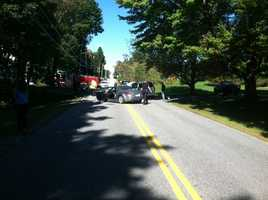 Police say three people were hurt in a crash involving a school van and a car in Windham on Wednesday.