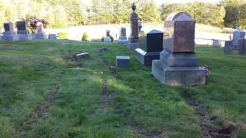 A mother-daughter dispute caused thousands of dollars in damage at Monmouth Cemetery, according to police