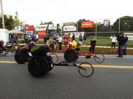 Racers in the wheelchair division leave the start line in the 22nd Annual Maine Marathon in Portland on Sunday.