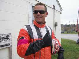 Driver Drew Campbell wearing a pink armband. Campbell is one of the drivers who donated his commission.
