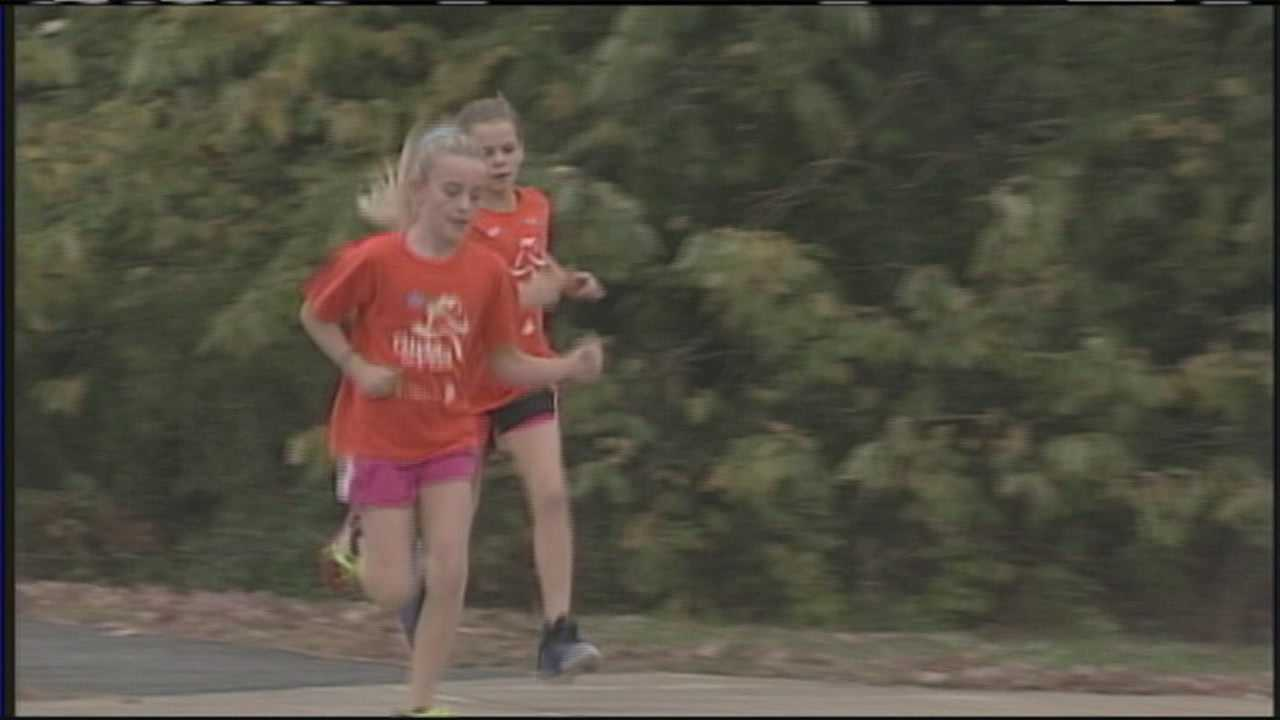 Students lace up running shoes for 'Girls On The Run 5K' in New Gloucester