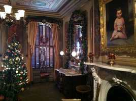 One of Victoria Mansion's many rooms is decked out in holiday finery.