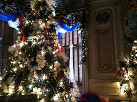 A Christmas tree shimmers in one of the rooms at the Victoria Mansion in Portland.