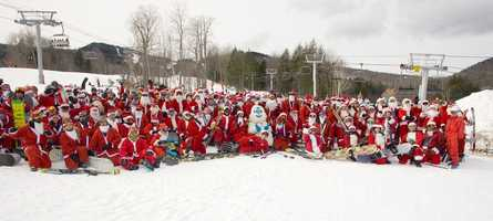 On Sunday, hundreds of skiing Santas hit the slopes at Sunday River.