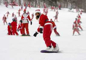 More than 200 people dressed up as Santa Claus to get a free day of skiing at the resort's 14th annual Santa Sunday fundraiser.