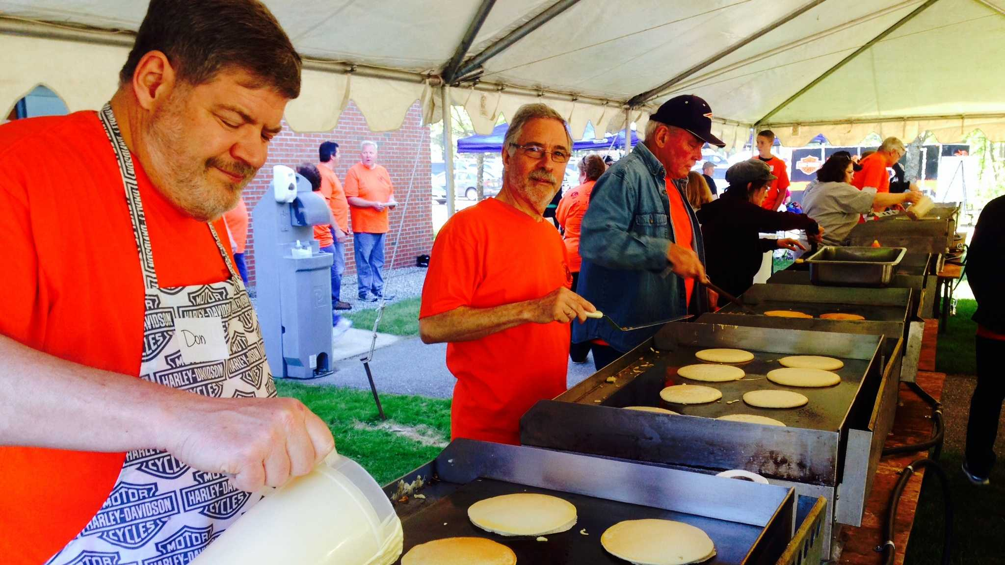 Volunteers serve up pancakes for Kiwanis