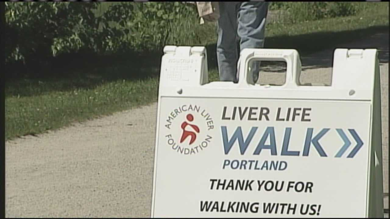 Survivors and their families walk to fight liver disease