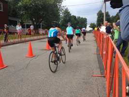 Tri for a Cure competitors pedal along the fifteen-mile bicycle course in South Portland on Sunday morning.
