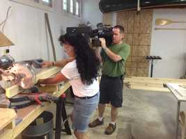 He and his wife assemble the 5-by-8-foot prefabricated panels.