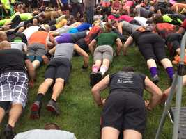 Participants warm up with push-ups before Saturday's Tough Mudder.