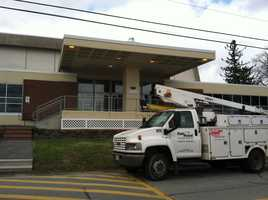 Fairpoint installs communications lines at Southern Maine Community College for the president's visit on Friday.
