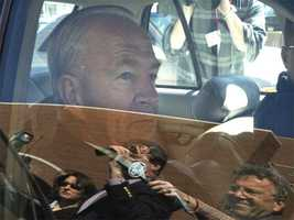 Jackie Bulger is seen through his car window as he was pursued by reporters and cameras April 10, 2003, after he pleaded guilty to perjury and obstruction of justice charges.