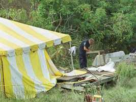 A State Police officer is seen over a sifting table Sept. 22, 2000, at the search scene in Quincy, Mass., where authorities discovered the remains of a man, believed to be a Bulger victim.