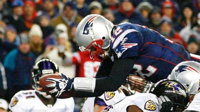 Tom Brady scores on a quarterback sneak in the fourth quarter to help lift the New England Patriots over the Baltimore Ravens in the 2012 AFC Championship game 23-20