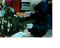 "Franklin Robbery ((Press Release))On 04/07/2012 at approximately 2224 hours Franklin Police were dispatched to the Franklin Mini-Mart, 221 So. Main St., reference to a past tense armed robbery. The suspect, who displayed a firearm, was described as a white male, approximately 5'4"" – 5'6"" tall and 130 – 150 lbs, wearing a dark blue hooded sweat shirt with a white oval shaped emblem on the left chest area, blue jeans, white gloves having red colored material on the palms, and a black ski mask with green colored graphics over the nose and neck area. The suspect was also carrying a dark colored backpack with four (4) triangular shapes on the front.Anyone with information regarding this incident is encouraged to contact the Franklin Police Crime Line at (603) 934-4092 or Franklin Police Department at (603) 934-2535."