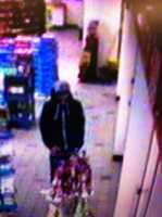 Rochester Theft ((Press Release)) On 03-02-12 at approximately 23:19 the Rochester Police received a call of a theft of beer located at the Rt 11 Shell Gas station. The male clerk advised that 2 suspects had entered the store and one of the suspects  attempted to steal two 30 packs of beer while the other suspect attempted to distract the clerk.   While enroute to take this report a robbery  call came in  at the Milton Rd Shell Gas Station occurring 10 minutes later, officers were unable to  immediately respond to the beer theft.  Upon  returning to the beer theft call it was discovered that the same 2 suspects from the robbery  on Milton Rd  also committed this offense which is classified as an attempted robbery , by theft, accompanied with the suspects fighting with the clerk attempting to take the beer by force.  Suspect 1 is described as being a white male , with a black hooded sweat shirt wearing a tan base ball cap . The sweat shirt jacket had large thick draw stings in the hood area as opposed to traditional style drawstrings.  The jacket also had a large white zipper section down the front of the jacket.   This suspect was very thin and small in stature and was wearing blue jeans and white sneakers with black thick style laces.  ( he had the same clothing on at the Milton Rd Shell Gas Station robbery minutes later, with the exception of the hat)  The second suspect was a white male was wearing a two tone North Face jacket,  the jacket has a  black shoulder and arms section  with a lighter gray torso area . The jacket has the North Face logo on the left chest area and this suspect was wearing white sneakers that had some black on the tongue area. Suspect 2 is described as having a thin build and pointy ,thin,  crooked nose.   (suspect 2 wears the same clothing to the Milton Rd Robbery). The suspects from this beer theft robbery,  are the same suspects that completed a robbery at the Milton Rd Shell 10 minutes later where they received cash. No one was hurt in the robbery and no weapons were shown.  Suspect fled on foot toward Little Falls Bridge rd  Anyone having any information on this robbery is asked to contact Det Michael Mundy of the Rochester Police Department 330-7128