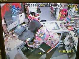 Goffstown Robbery ((Press Release)) Goffstown Police police are investigating a Robbery at the Sunoco Station on Mast Rd which occurred at 9:45pm on November 26th. The suspect is described as an African American Male ,mid to late 20's, Approx 6 feet tall, Black hooded sweatshirt with a colorful photograph collage on the back side,Black sweat pants, Black sneaker with white socks and blue undershirt. He fled on foot up College Rd. with cash draw and undisclosed amount of cash. Anyone with information is asked to call Goffstown Police at 603-497-4858.