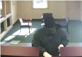 Newington Bank Robbery ((Press Release)) Newington Police are investigating a robbery at the TD Bank on Woodbury Avenue on November 2, 2011. The robbery occurred around 10:20a.m. The suspect is described as a white male, 5 feet 10 inches tall, wearing white gloves, a green jacket, baggy blue jeans, black tennis shoes with white trim and soles. The suspect showed an eight-inch knife to the teller during the robbery. Anyone with information is asked to call Newington Police at 603-431-5461
